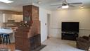 Beautiful natural brick, double-sided fireplace - 5609 OTTAWA RD, CENTREVILLE