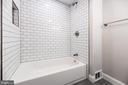 Subway tiling in bath shower. - 7605 LAURALIN PL, SPRINGFIELD