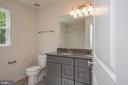 Hall bath offers double vanity - 102 MONROE ST, LOCUST GROVE