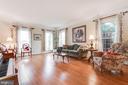 Large dining room with gleaming hardwood floors - 20277 DAWSON MILL PL, LEESBURG