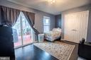 Bedroom with walkout to Patio - Lower Level - 22462 FAITH TER, ASHBURN