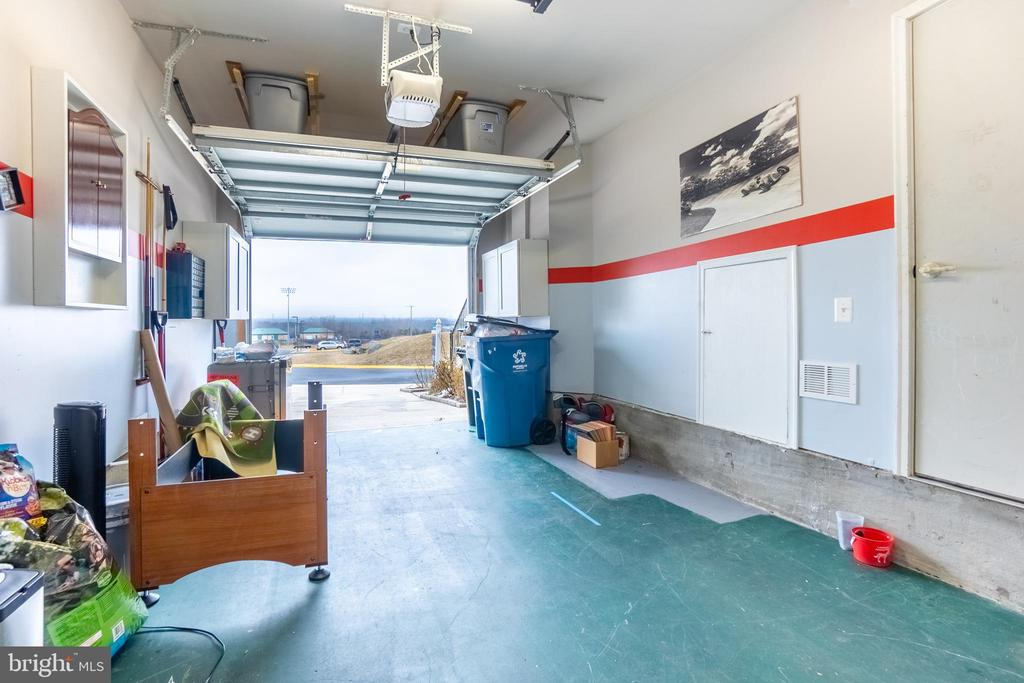 Garage with extra storage space on top with bins - 22462 FAITH TER, ASHBURN