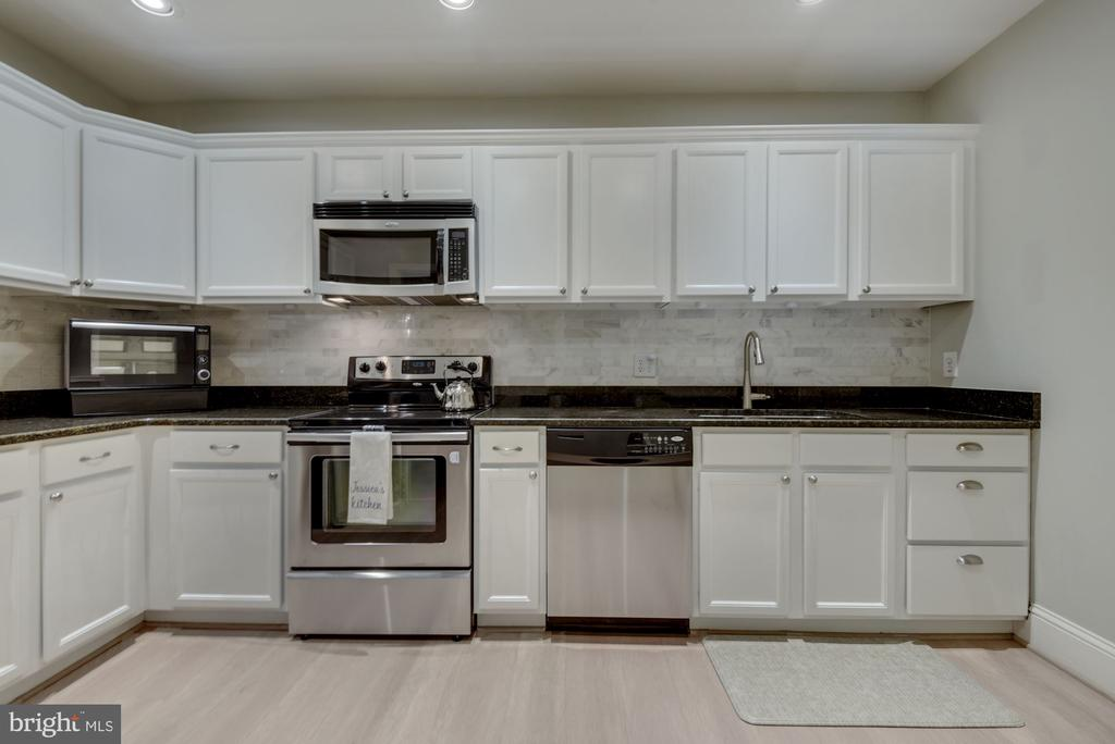 Kitchen - LOADS of Meal Prep Space + Storage Space - 1610 BELMONT ST NW #D, WASHINGTON