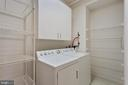 Huge laundry room with shelving and cabinets - 19365 CYPRESS RIDGE TER #1108, LEESBURG
