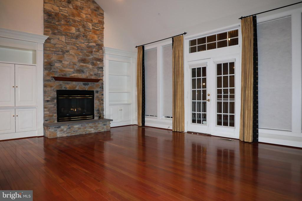Family Room, gas fireplace, door to deck - 3705 GLEN EAGLES DR, SILVER SPRING