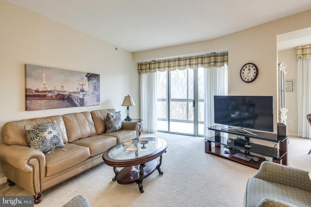 Family Room opens to dining room and den - 3100 N LEISURE WORLD BLVD #203, SILVER SPRING