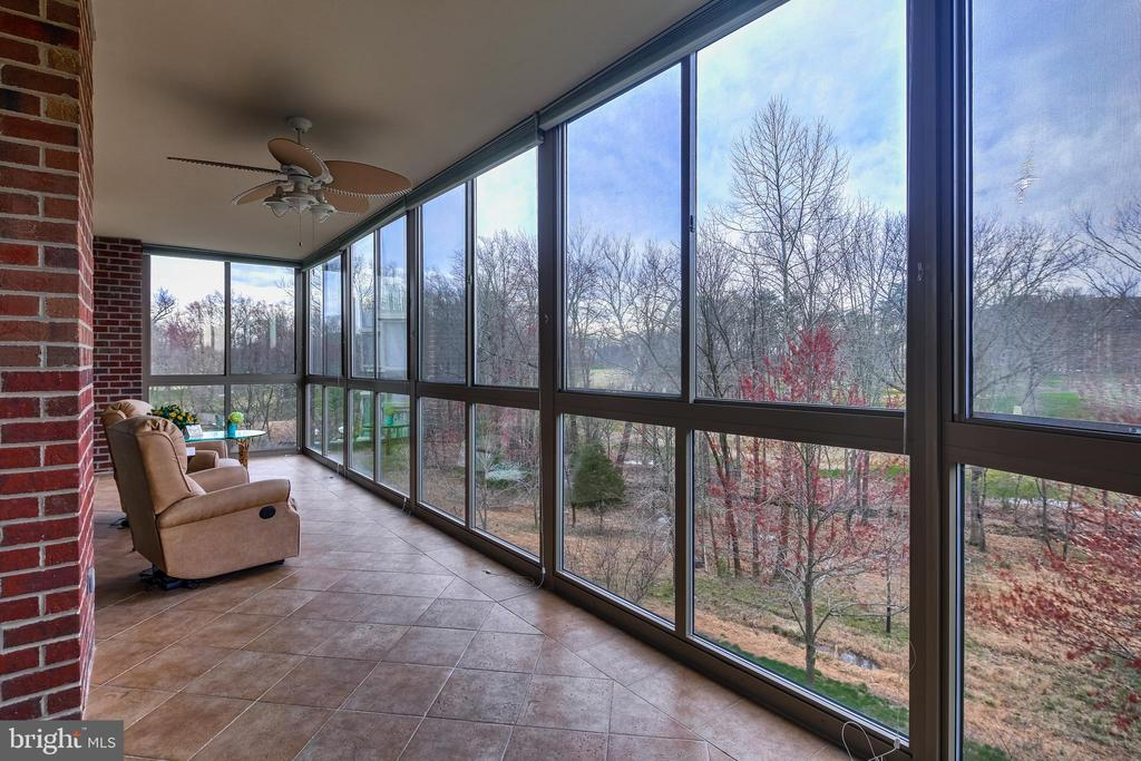 Sunroom overlooks the golf course - 3100 N LEISURE WORLD BLVD #203, SILVER SPRING