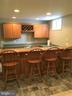 Custom built bar with wine storage - 311 OAKCREST MANOR DR NE, LEESBURG