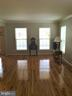 Gleaming hardwood floors in large Living Room - 311 OAKCREST MANOR DR NE, LEESBURG