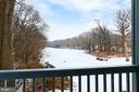 View of golf course from your private balcony! - 2071 WETHERSFIELD CT, RESTON
