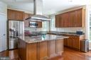 Gorgeous kitchen has custom hood, central island - 21382 FAIRHUNT DR, ASHBURN