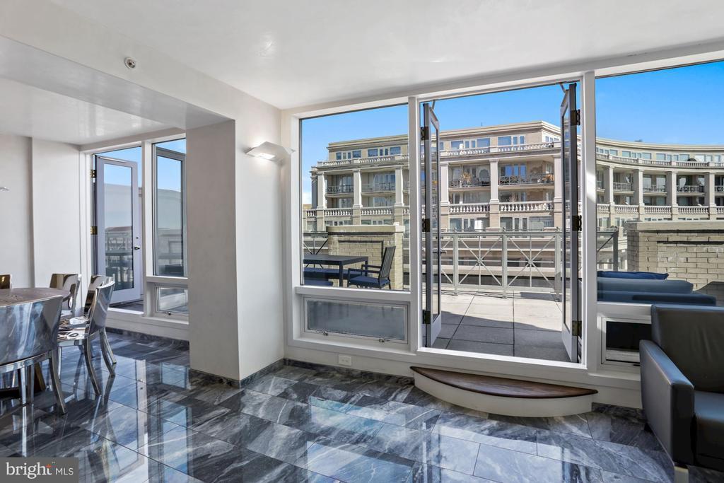 Two sets of French doors lead to balcony - 801 PENNSYLVANIA AVE NW #1026, WASHINGTON