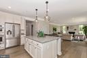 Kitchen with included Granite - 6625 ACCIPITER DR, NEW MARKET