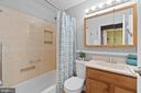 Full bath has plenty of hidden storage! - 603 S DOGWOOD ST, STERLING