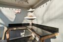 Custom-built granite topped counter. - 603 S DOGWOOD ST, STERLING