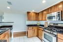 Gourmet kitchen w/ stainless steel appliances - 1201 N GARFIELD ST #909, ARLINGTON