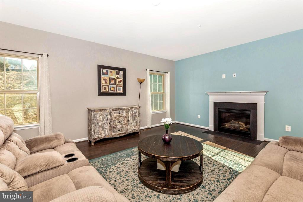 Family room with gas fireplace - 8714 PRESTON DR, FREDERICK