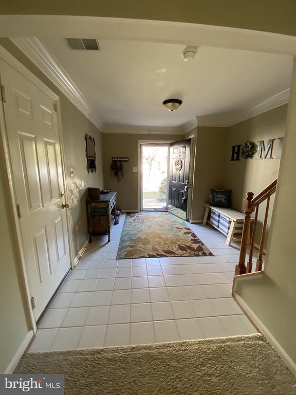 Storm Door, Closet & Door to Garage - 14103 RED ROCK CT, GAINESVILLE