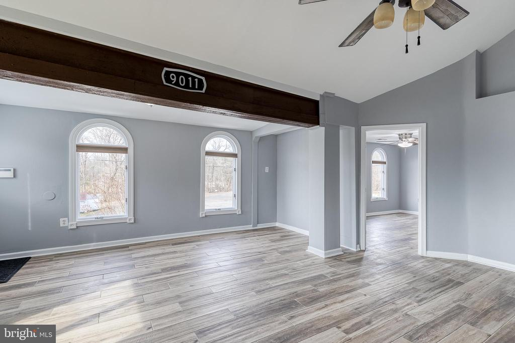 Living/dining room with lots of natural light - 9011 BACKLICK RD, FORT BELVOIR