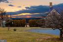 The main house at sunset - 21943 ST LOUIS RD, MIDDLEBURG