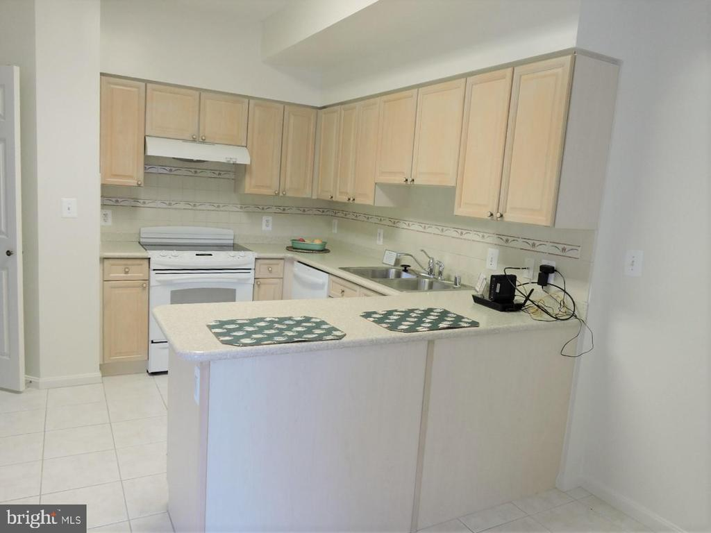 View from eating space to Convenient Kitchen - 19365 CYPRESS RIDGE TER #416, LEESBURG