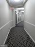 Hallway back to elevators to Lobby Level - 19365 CYPRESS RIDGE TER #416, LEESBURG