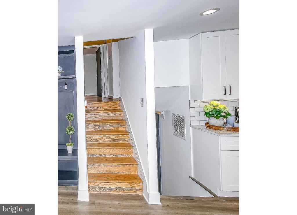Split level staircase -- Upper, Main, Lower - 7419 JERVIS ST, SPRINGFIELD