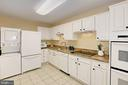 Updated Kitchen w/granite counters white cabinetry - 8380 GREENSBORO DR #1017, MCLEAN