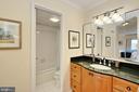 Primary BA w/ elegant vanity & updated lighting. - 8380 GREENSBORO DR #1017, MCLEAN