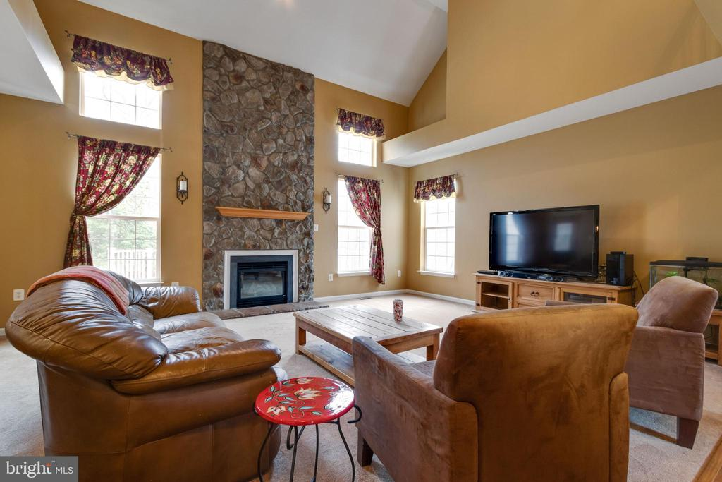 Floor to ceiling stone gas fireplace - 15230 BOWMANS FOLLY DR, MANASSAS