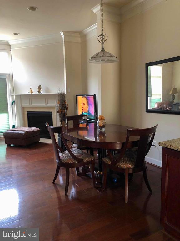 Dining room leading to living room - 23600 BENNETT CHASE DR, CLARKSBURG
