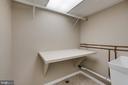 Folding area in laundry room - 604 N LATHAM ST, ALEXANDRIA