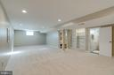 Large family room with custom shelving - 604 N LATHAM ST, ALEXANDRIA