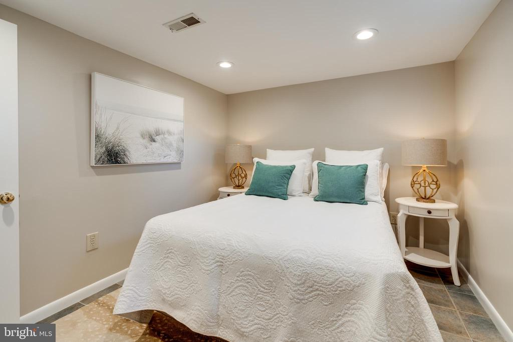 Basement bedroom has tile flooring - 604 N LATHAM ST, ALEXANDRIA