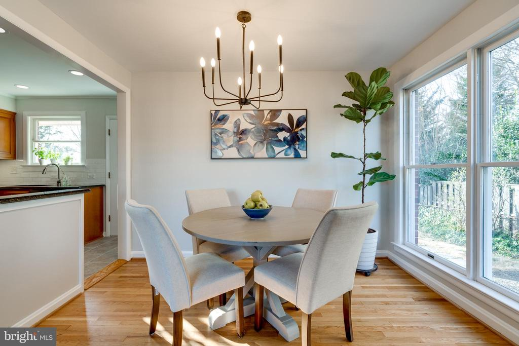 Dining area with floor to ceiling windows - 604 N LATHAM ST, ALEXANDRIA