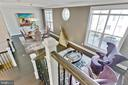 View from stairs to living and dining area. - 312 GOODALL ST, GAITHERSBURG