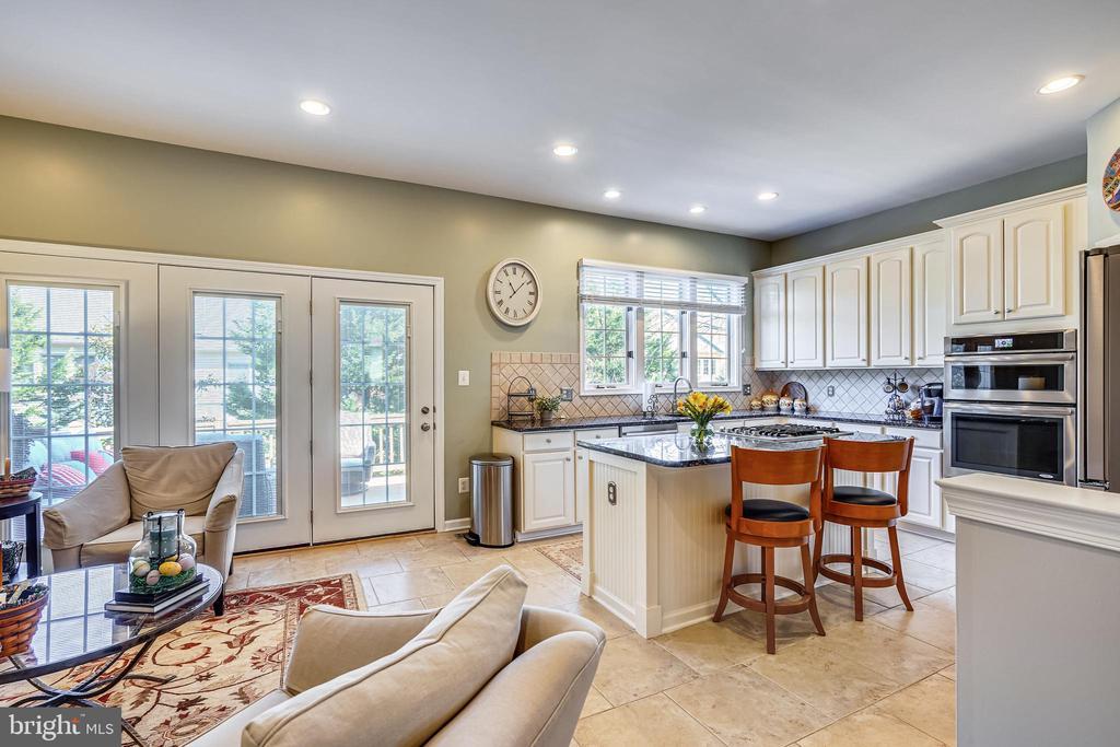 Bright kitchen with recessed lighting. - 4124 TROWBRIDGE ST, FAIRFAX