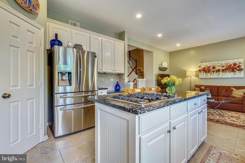 Newer refrigerator and gas cooktop. - 4124 TROWBRIDGE ST, FAIRFAX
