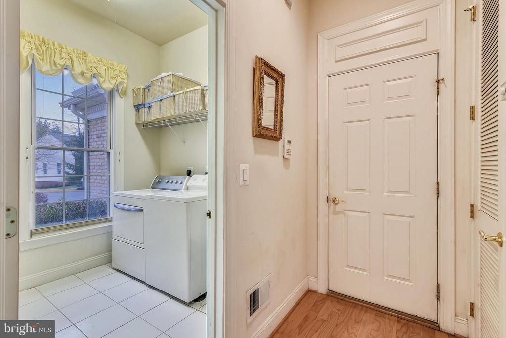 Laundry room off of garage. - 5312 TREVINO DR, HAYMARKET