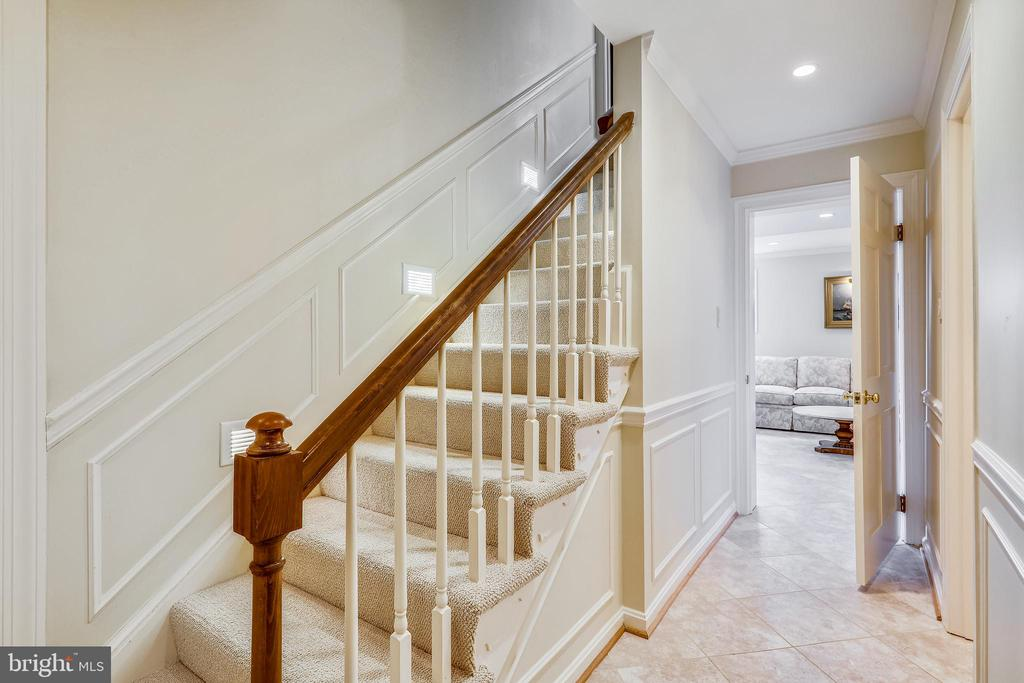 Lighted stairway to lower level - 3903 BELLE RIVE TER, ALEXANDRIA