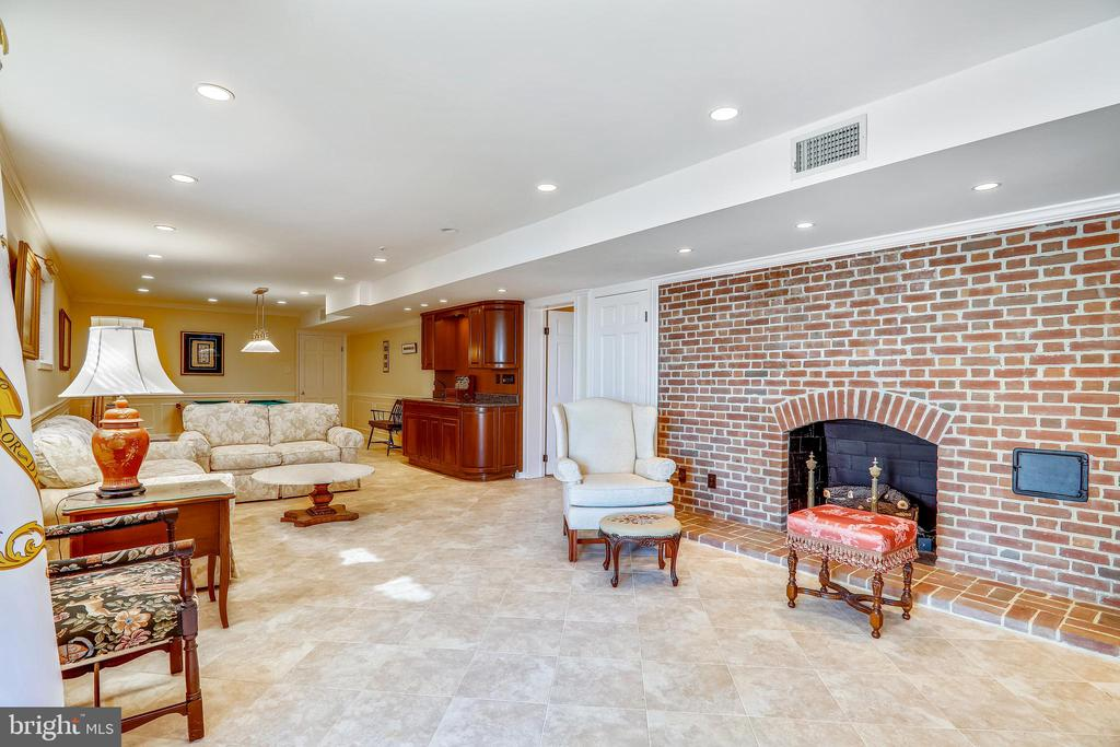 Recessed lights, fireplace, and bar in lower lvl - 3903 BELLE RIVE TER, ALEXANDRIA