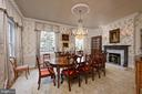 Elegant formal dining room offering a fireplace - 711 PRINCE ST, ALEXANDRIA