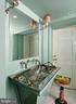 Charming half bath w/curved door to entrance hall - 711 PRINCE ST, ALEXANDRIA