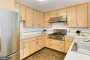 Kitchen with gas cooking - 6802 GLENMONT ST, FALLS CHURCH
