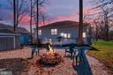 Cozy Fire pit in the rear of the home - 1106 LAKEVIEW PKWY, LOCUST GROVE