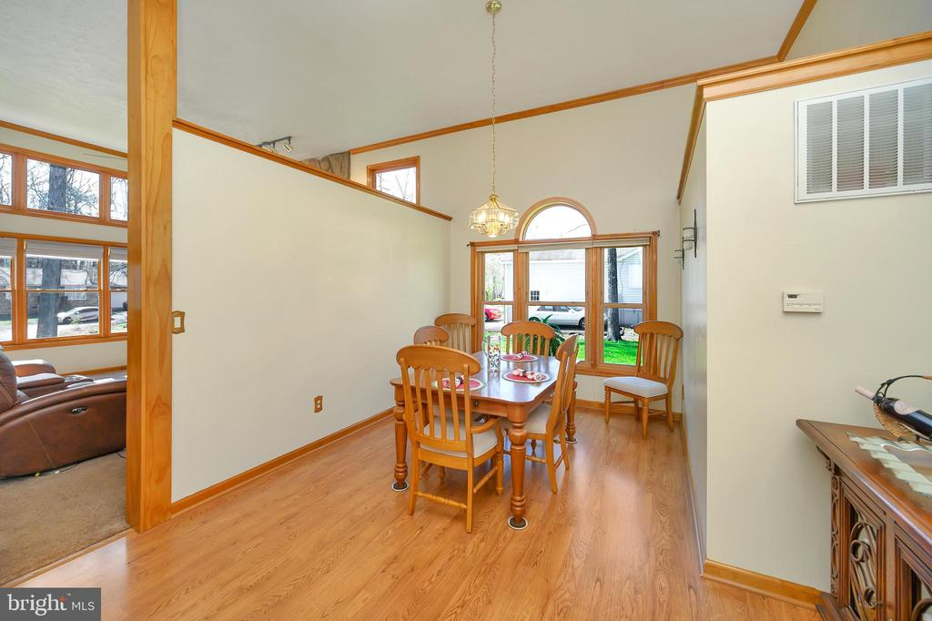 Generous Dining room steps away from the kitchen - 1106 LAKEVIEW PKWY, LOCUST GROVE
