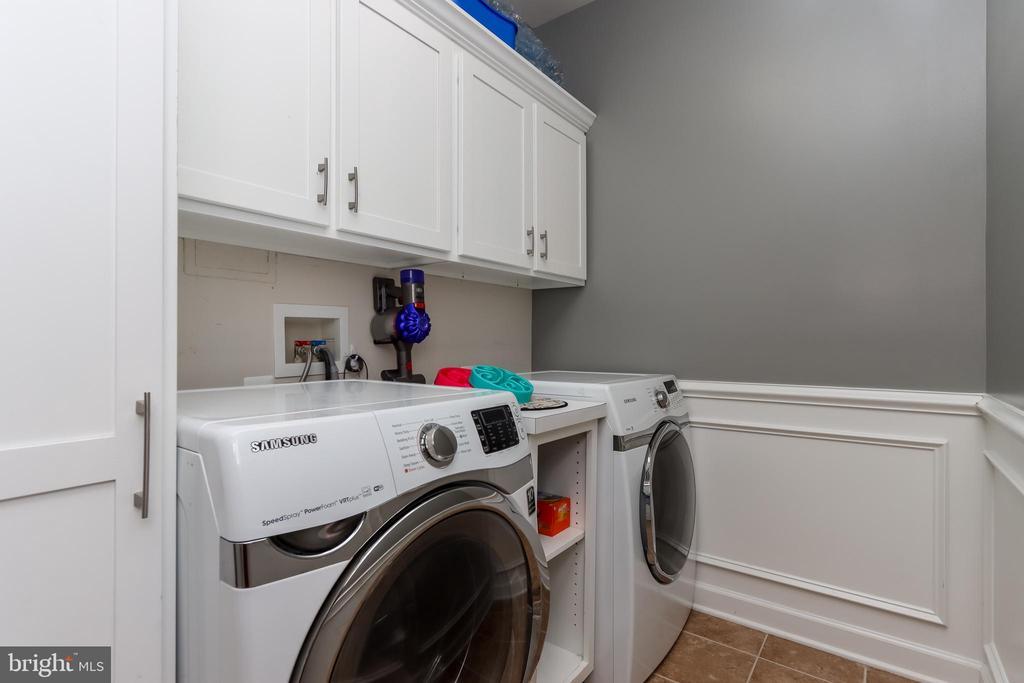Laundry room has plenty of storage - 113 MAROON CT, FREDERICK
