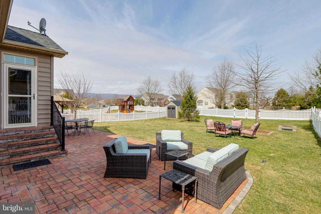 Relax or entertain on the back patio - 113 MAROON CT, FREDERICK