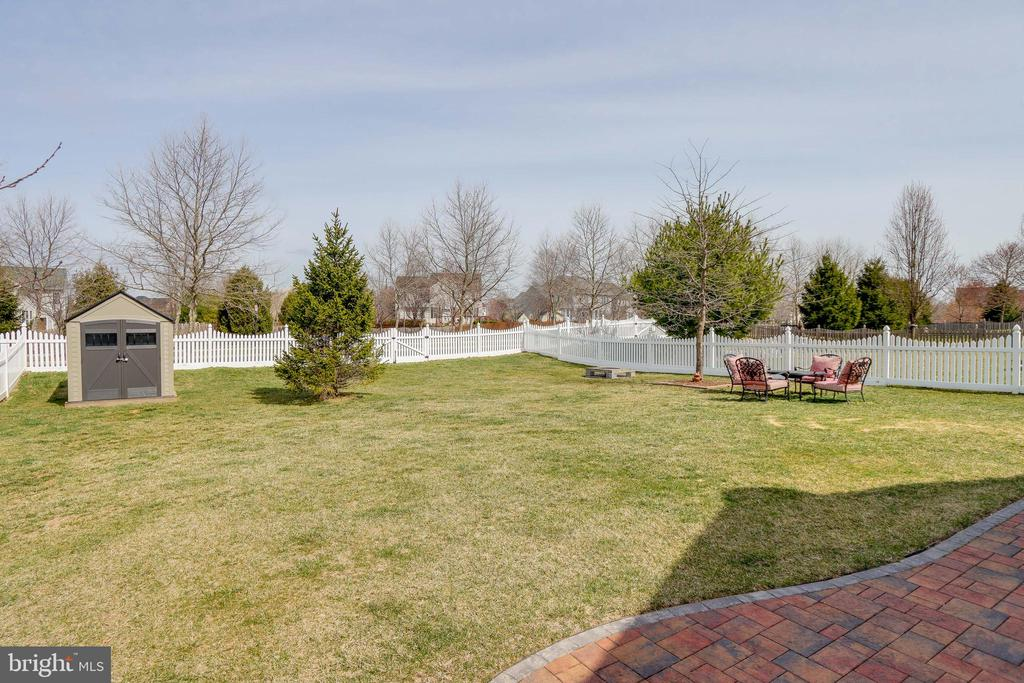 Backyard is fully fenced and a shed! - 113 MAROON CT, FREDERICK