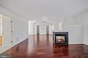 Hardwood floors, cozy two sided gas fireplace - 1306 MONROE ST, HERNDON